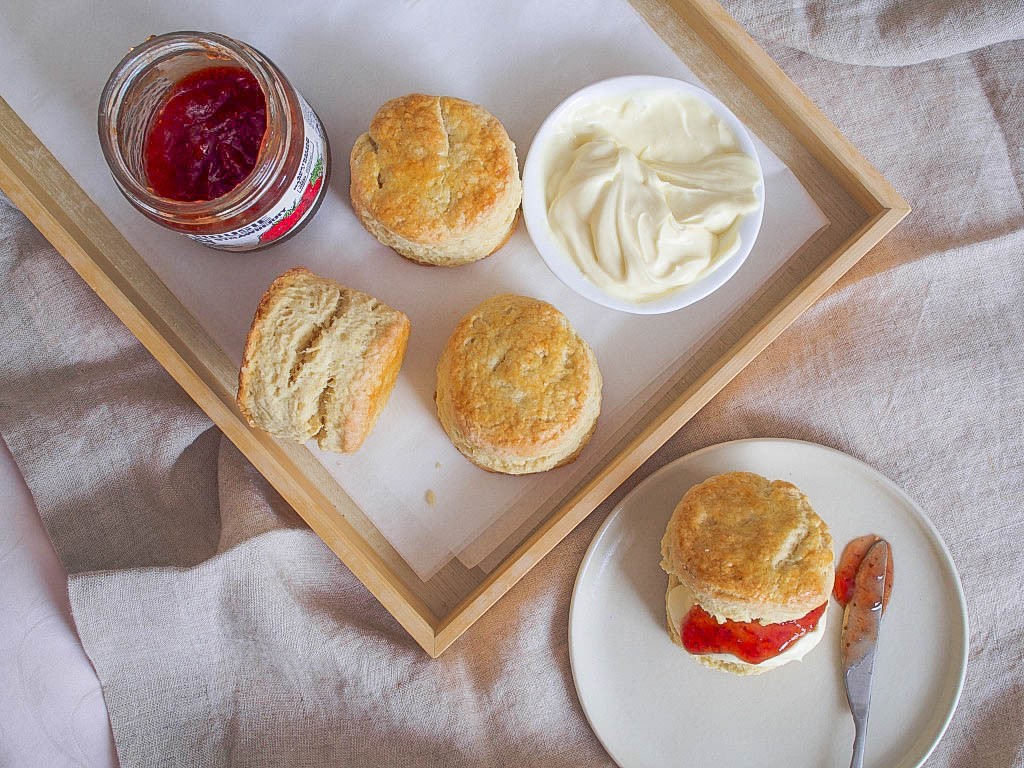 scones on tray with jam and cream