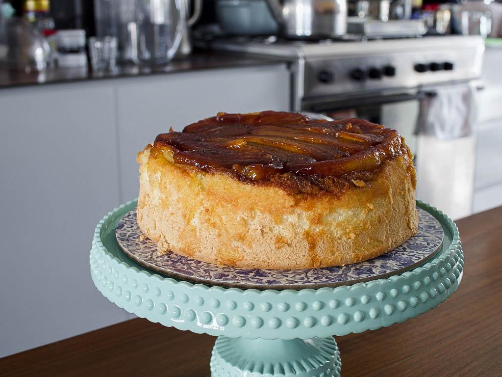 banana upside-down cake on cake stand
