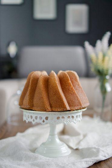 butter bundt cake on cake stand