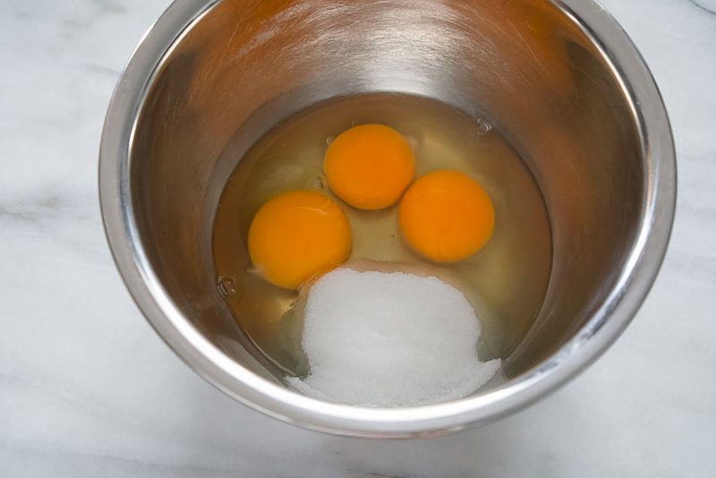 eggs and sugar in mixing bowl