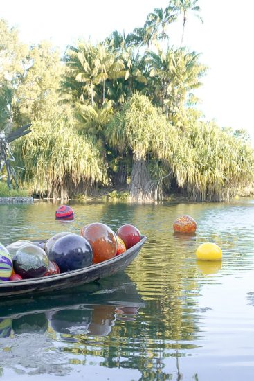 colourful balls in boat on river